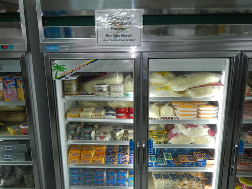 Imported cheese in refrigerated display at supermarket