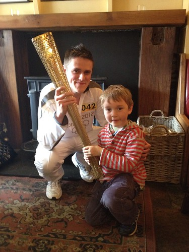 Charlie and an Olympic torch