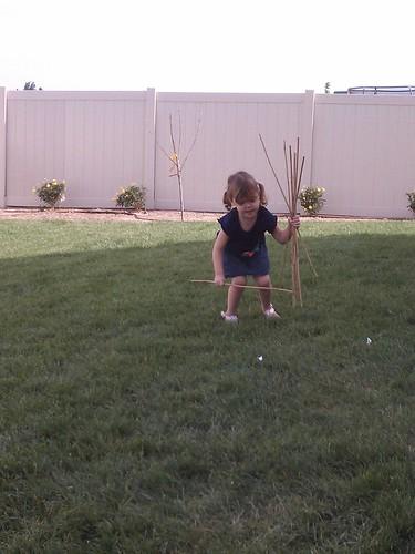 This girl loves sticks