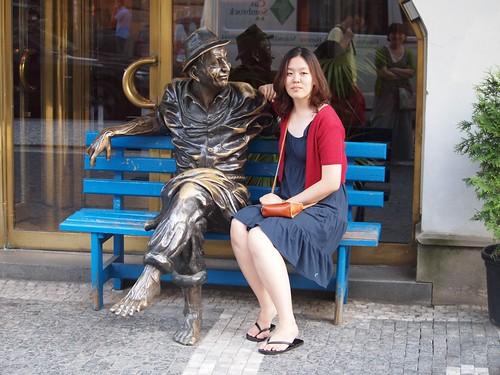 Blue bench + bronze guy + pretty girl