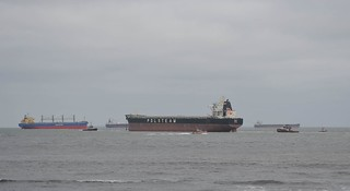 A crew aboard a 45-foot Response Boat - Medium from Coast Guard Station Little Creek, Va., maintains a safety zone around the 751-foot bulk carrier Ornak, Friday, April 18, 2014. The ship was refloated Friday morning and moved to Lynnhaven anchorage for inspections.
