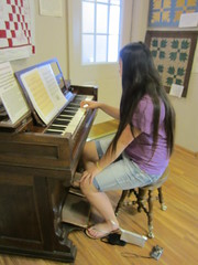 Sophia Playing Pump Organ