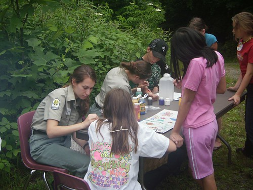 Forest Service employees painted plants and animals on kids who attended the 5th annual National Get Outdoors Day event on the Pisgah National Forest.