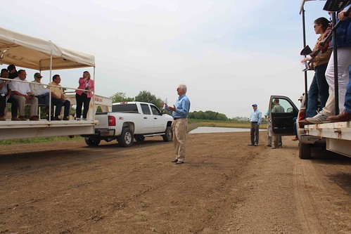 NRCS engineer Paul Rodrigue explains how Stovall Farms captures and reuses water to irrigate its fields, minimizing the runoff of nutrients into nearby streams and the need to use underground water sources.