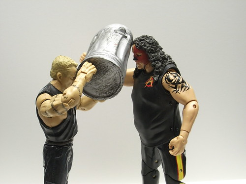 ECW's Sandman hits Abyss with a garbage can.