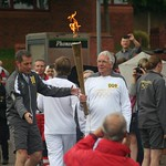 And the relay starts again -Olympic torch carried through Burslem