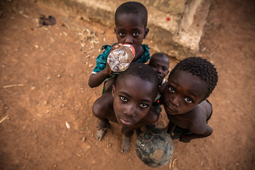 Portrait of children in Gurunsi villages are formed by sukhala houses, which are decorated hand painted by the women of the village, tiebele, burkina faso by ronnyreportage