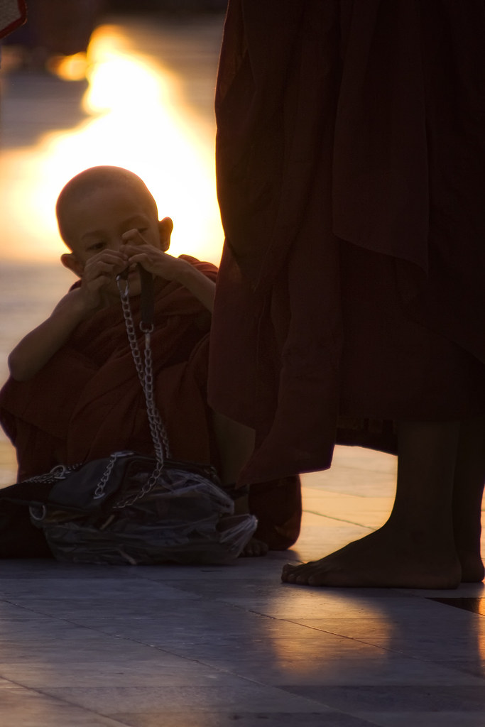 A Novice Monk Plays With A Chain