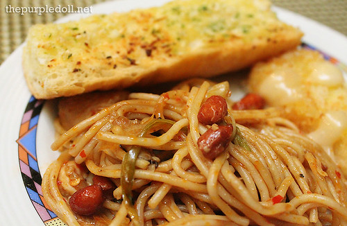 Plate of Charlie Chan Pasta, Garlic Bread and Seafood Roll