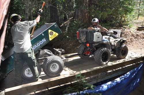 Mike Wubbels, a member of The Stewards of the Sierra National Forest volunteer group, works with a forest trailshot crewmember on a bridge replacement for an off-highway vehicle trail.  Their work involved installing water bars to prevent sedimentation and protect water quality.