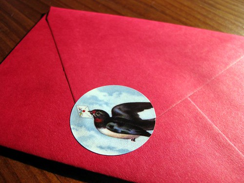Letterbird seal on red envelope