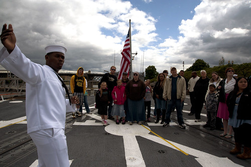Quartermaster 1st Class Clarence Roach, assigned to USS William P. Lawrence, leads a public tour during Fleet Week.