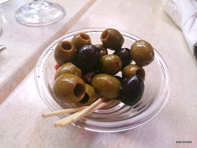 Two different olives in a bowl