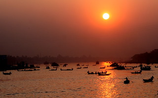 Boats crossing the river Buriganga