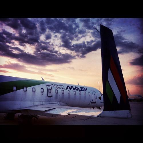 sunset clouds airplane airport hungary budapest transport apron crj canadair crj900