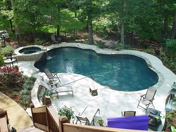 Pool into steep slope explore poolbydesign 39 s photos on for Pool design on a slope