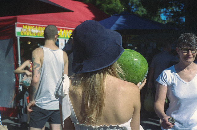 Lady carrying watermelon