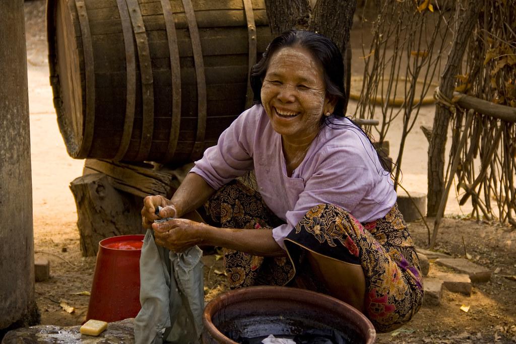 A Burmese Woman Washing Clothes