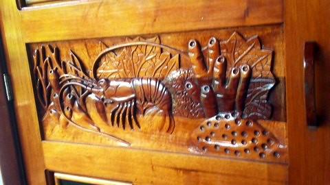 Wood carving on door in Honduras