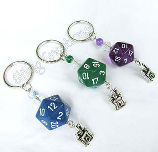 Castle dice keychains - purple, green, blue