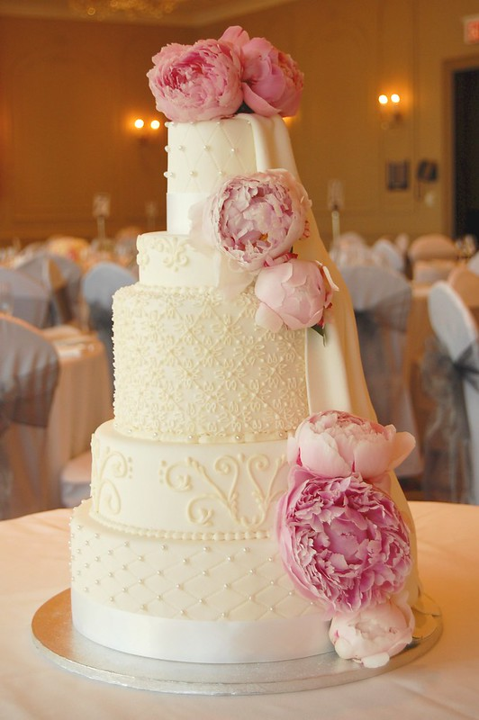 White wedding cake with pink peonies