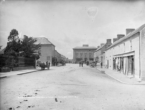 trees ireland bicycle children suits donkey bakery material ladder cart cloths crate railings sugarbeet dung marketsquare policemen phelan glassnegative 1890s regulations carlow leinster robertfrench williamlawrence nationallibraryofireland bagenalstown fuls lawrencecollection lawrencephotographicproject federationforulsterlocalstudies federationoflocalhistorysocieties hkelly kellysdrapers