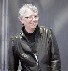 textile(1.0), leather jacket(1.0), leather(1.0), jacket(1.0), person(1.0), portrait(1.0),