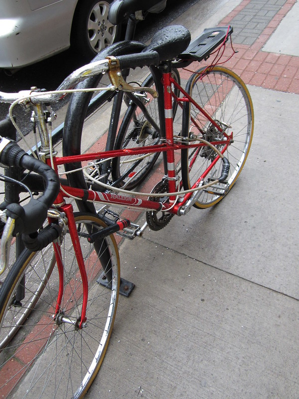Image of Red Raleigh Mixte bike