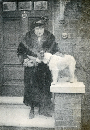 Lady with a fur coat and a dog.