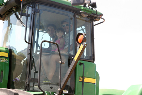 Kaidence takes a ride with Oak and Montana in the tractor