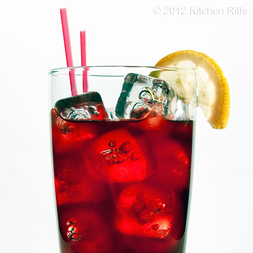 Sloe Gin Fizz with Lemon Garnish & Straws, White Background