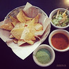 Chips and salsa with guacamole, tomato and tomatillo salsa in Vancouver BC by La Casita Gastown