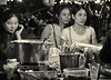 Shoppers in a night market, Phnom Penh, Cambodia, 2015 (B&W)