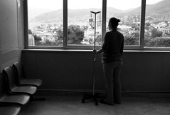 dehydrated pregnant girl looking out waiting room window