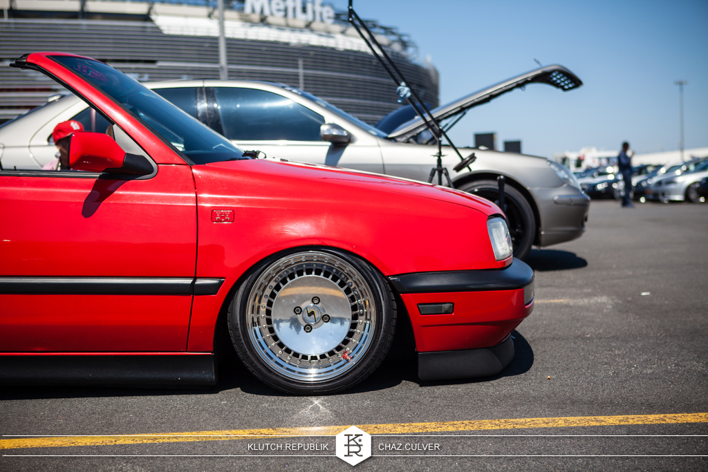red mk3 vw cabrio on airride and 3pc schmidt th-lines at eurofest 2012
