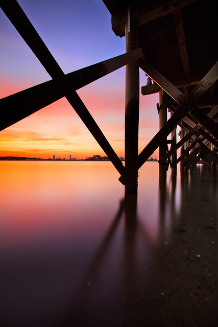 Under a Pier, a Sunset Over Boston