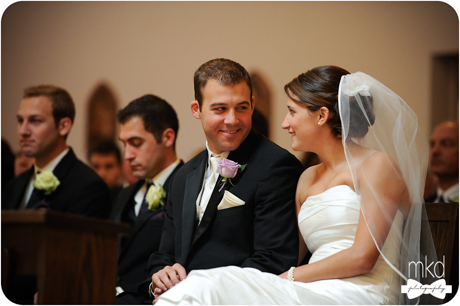 Bride & Groom smiling at each other during ceremony