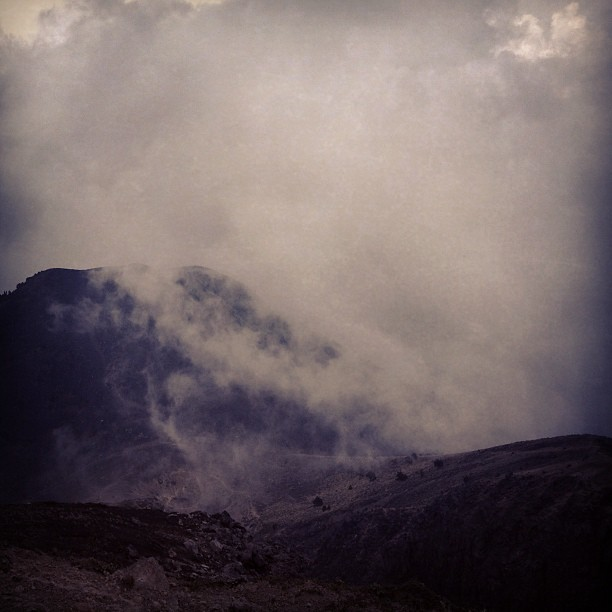 We made it to the crater, at 3976m! Barely visible, Fuego volcano erupting. #acatenango #guatemala