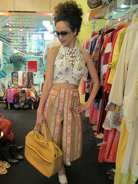1950s beads, 1980s Hilite sunglasses and 1970s printed halter top, 1970s bermudas and vintage travel bag from Granny's Day Out.