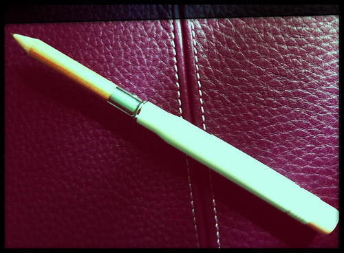 midori white brass pencil on a purple finchley
