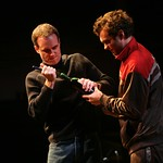 Ian (Jay Whittaker, l.) and drifter Laurence (Keith Gallagher) struggle to open a bottle of wine in the Huntington Theatre Company's production of Shining City, written by Conor McPherson and directed by Robert Falls.  Part of the 2007-2008 season.
