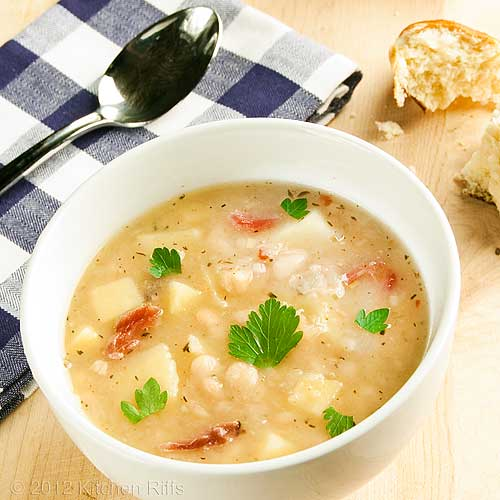 White Bean and Potato Soup with napkin and spoon