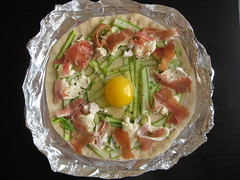 on goes the egg (and more pepper ... asparagus tips not shown)