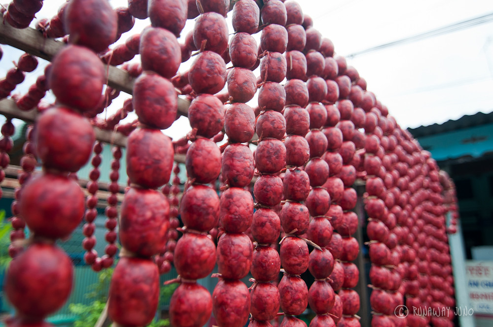 Drying the homemade sausages in Chau Giang