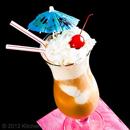 Root Beer Float with Cherry Garnish and Cocktail Umbrella