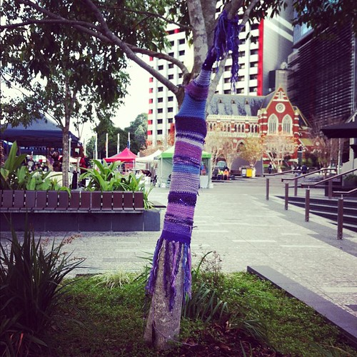 Another tree yarn bombed in King George Square @BrisStyle Craft Caravan