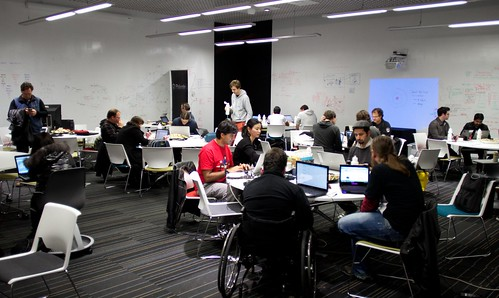 The room full of busy hackers