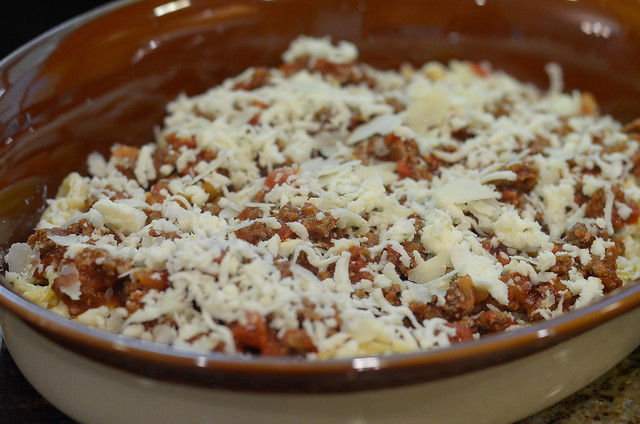 The casserole is topped with mozzarella and Parmesan cheese.