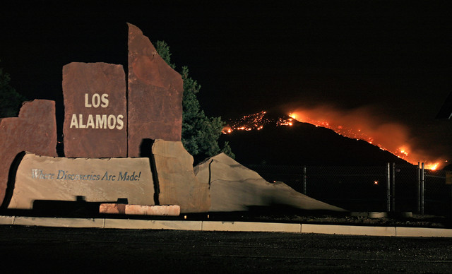 The Las Conchas Fire burns north and west of Los Alamos the night of July 4th giving recently returned residents a natural fireworks show.  Photo by Ethan Frogget.