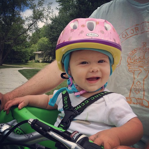 Papa and baby biking together